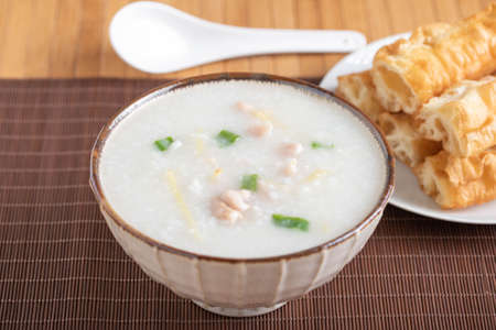 chinese chicken congee with bread stick 免版税图像