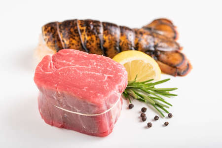 surf and turf, raw fillet mignon and lobster tail Banco de Imagens