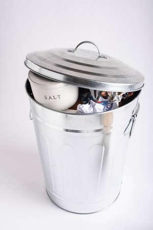 salt container in garbage bin, health image