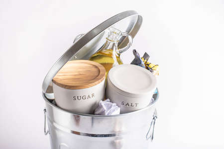sal, sugar, oil in garbage can, health concept image