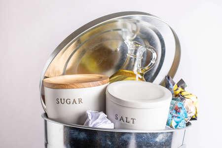 sal, sugar, oil in garbage can, health concept image Reklamní fotografie