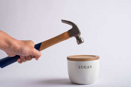 destroying sugar container with hammer