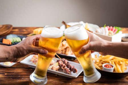 toasting image with beer and japanese izakaya food