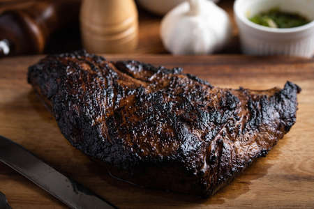 grilled tri tip steal on cutting board