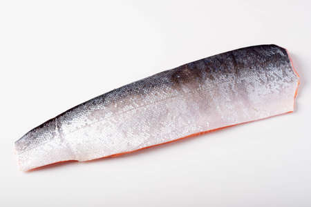 isolated skin side salmon fillet on white background