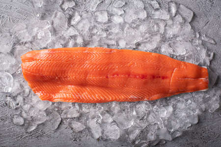 raw salmon fillet on gray background