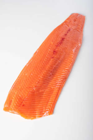 isolated whole raw salmon fillet on white background