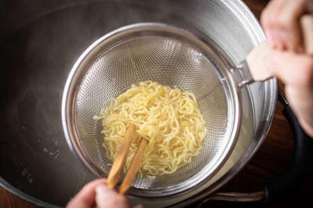 boiled japanese ramen noodle in strainer