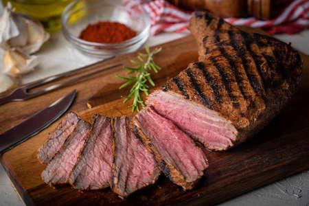 sliced tri tip seak marinated with santa maria sauce  on wooden cutting board Stock fotó