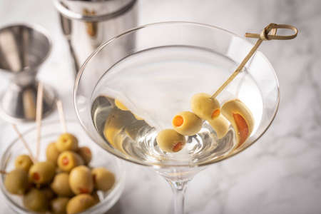 glass of martini on marble background Imagens