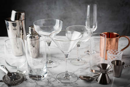 cocktail glasses and utensils on marble table