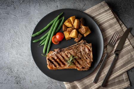new york strip steak on concrete background