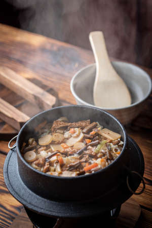 Kamameshi, japanese pot rice with autumn ingredients