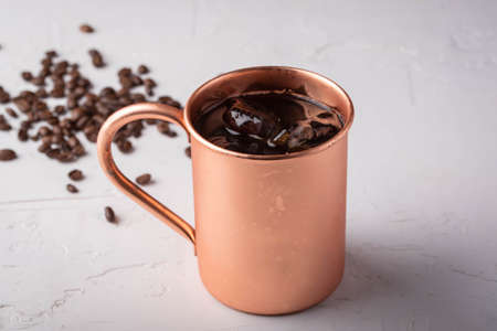 cold brewed coffee in copper mug
