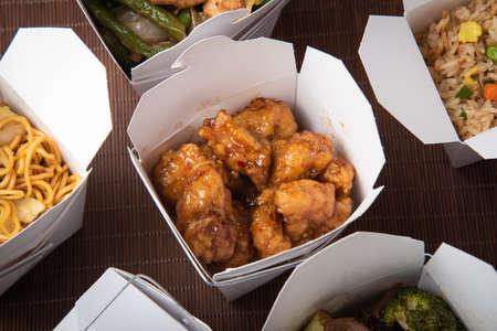 orange chicken in traditional american chinese box