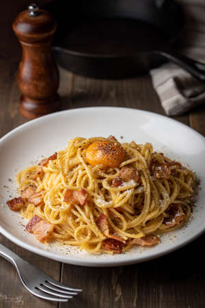 carbonara spaghetti with raw egg yolk on top