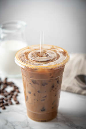iced coffee in disposable plastic cup