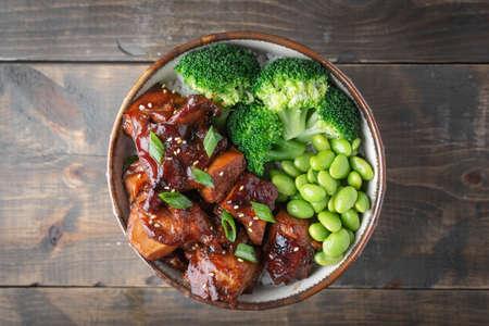 teriyaki chicken rice bowl with broccoli and edamame