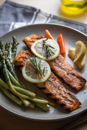 grilled salmon fillet on plate with asparagus