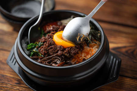 mixing korean famouse hot stone bowl bibimbap Stok Fotoğraf
