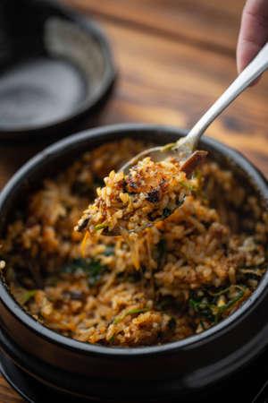 making crispy rice with korean hot stone bowl bibimbap