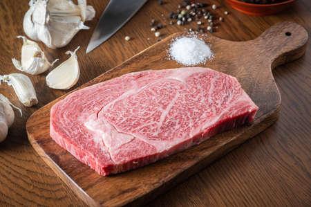 japanese wagyu ribeye beef on wooden cutting board