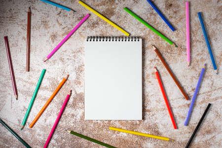 color pencils and sketch book for copyspace
