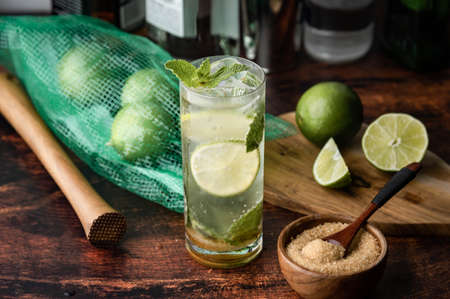 ice cold mojito on wooden background