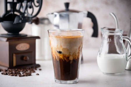 iced coffee with milk and dripping tools Archivio Fotografico