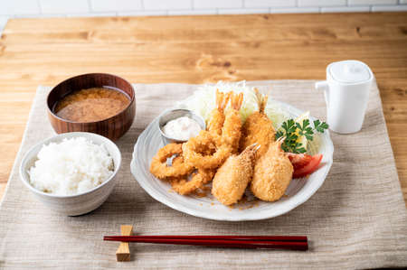 japanese deep fied seafood with rice and miso soup