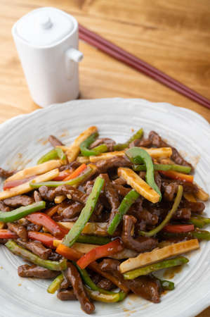 Chinese-style stir-fry containing green peppers and meat