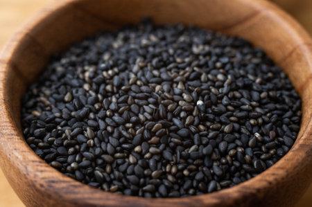 black sesame in wooden plate