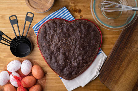 Heart shaped chocolate brownie on wooden table 免版税图像
