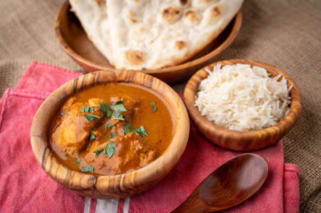 butter chicken curry with naan and basmati rice