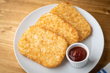 hash brown on white plate