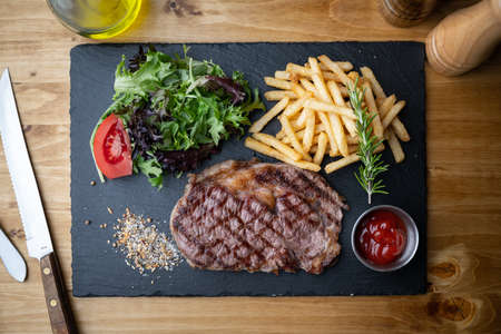 beef steak with salad and french fries