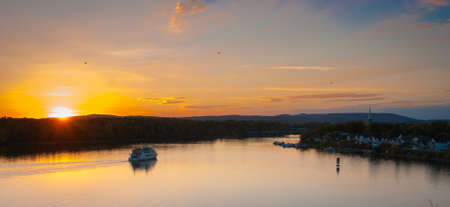 pleasure craft: Calm evening falls over the Ottawa river, while tourists ride the riverboat. Stock Photo