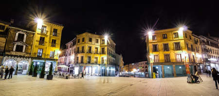 enduring: A night time view of the town square in Segovia Spain.