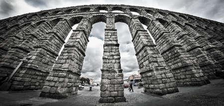 towering: Old Roman aqueduct at Segovia.