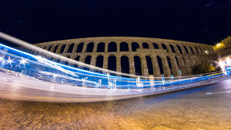 enduring: A bus drives through the shot of the famous Segovia Aqueduct.