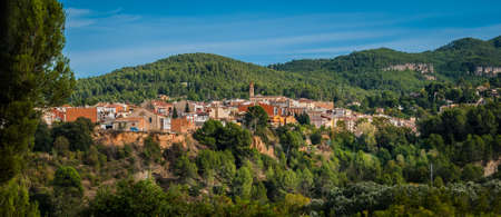 enclave: A small enclave of homes nestled in the hills of Spain. Stock Photo