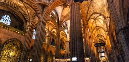 dimly: Inside a Gothic cathedral in Barcelona, Spain. Editorial