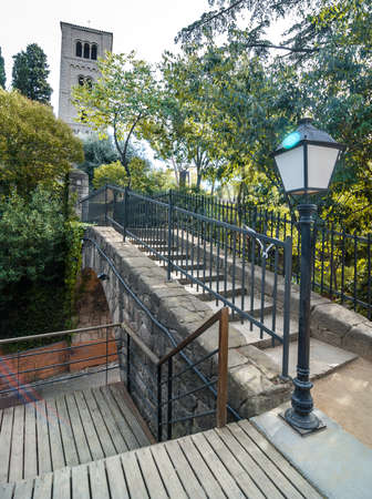 guardrails: Walkway through treed parks and gardens in older, inner villages of Seaside Barcelona, Spain. Stock Photo