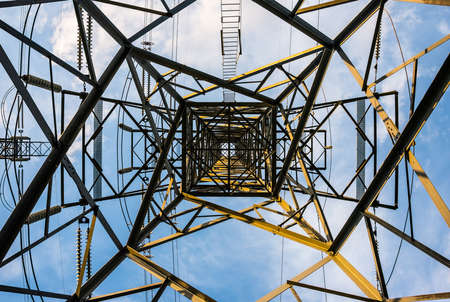 electric grid: Tower of Power.  An electrical distribution tower offers up an interesting single point perspective from below Stock Photo