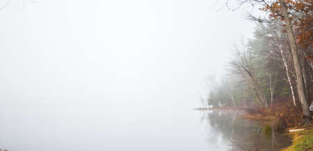 early fog: Early morning fog on a lake near Ottawa, Ontario. Stock Photo