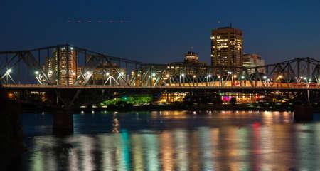 Alexandra rail and traffic bridge at night.   Spanning the Ottawa River, the Alexandra bridge joins Ottawa, Ontario to Hull Quebec,