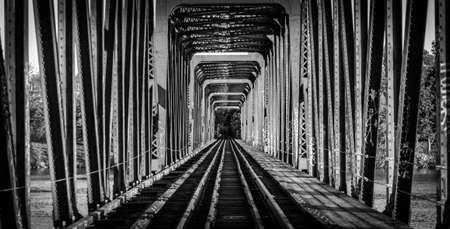 yesteryear: Retired and no longer used, Prince of Wales railway bridge, Ottawa, Ontario.  Black and white view down the tracks on an old railway bridge from yesteryear.
