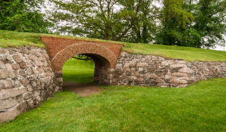yesteryear: Historical site of yesteryear, a brick archway supports an overpassing route, formerly used by soldiers to patrol this historic site in Nova Scotia, Canada.