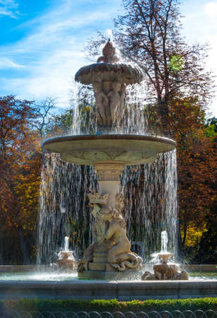 cherubs: Flowing fountain in Retiro Park of Madrid, Spain on a warm November day.  Warm November day in one of the main parks of the city.