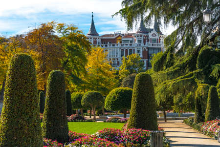 enjoy space: Gardens and green space in Retiro Park of Madrid, Spain on a blue-sky sunny day.  Citizens and tourists alike enjoy the gardens on a fabulous warm November day.